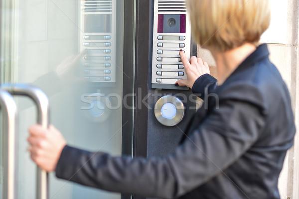Femme poussant bouton affaires maison Photo stock © stockyimages