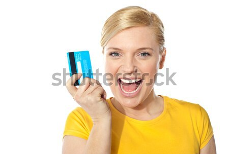 Smiling young girl holding debit-card Stock photo © stockyimages