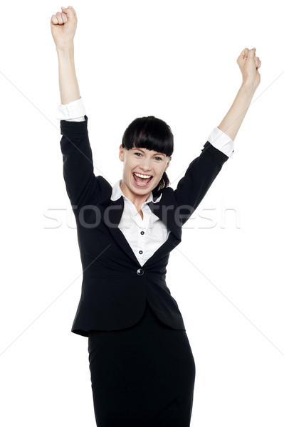 Jubilant corporate lady throwing up her hands Stock photo © stockyimages