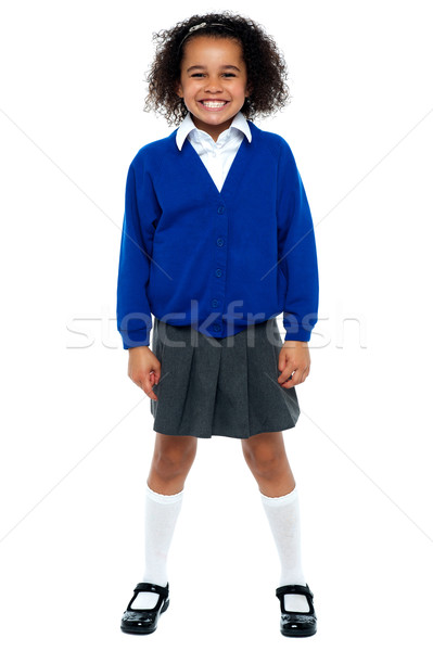 Full length portrait of a joyous African school girl Stock photo © stockyimages
