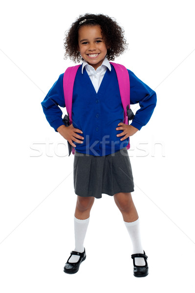 Primary school girl posing confidently Stock photo © stockyimages