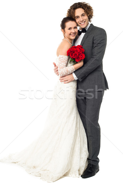 Lovely young married couple embracing warmly Stock photo © stockyimages