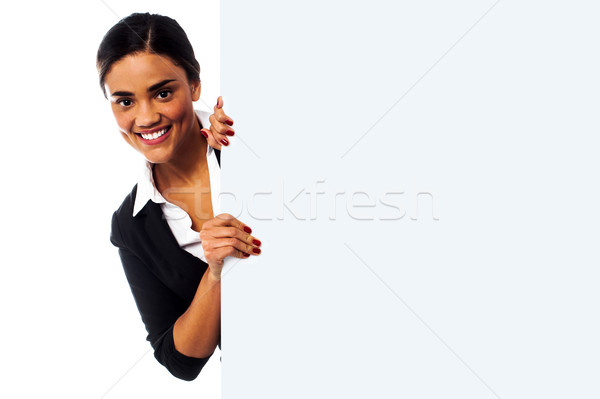 Female model holding blank white ad board Stock photo © stockyimages