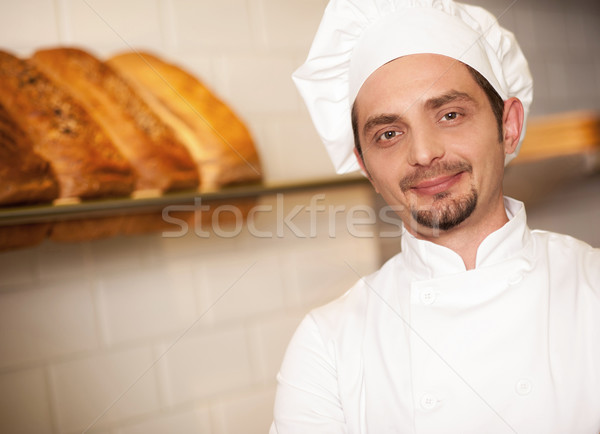 Bakery owner dressed in chef's attire Stock photo © stockyimages