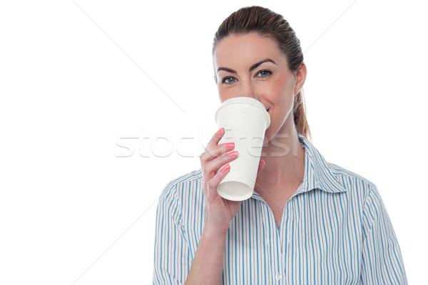 Female employer enjoying beverage Stock photo © stockyimages