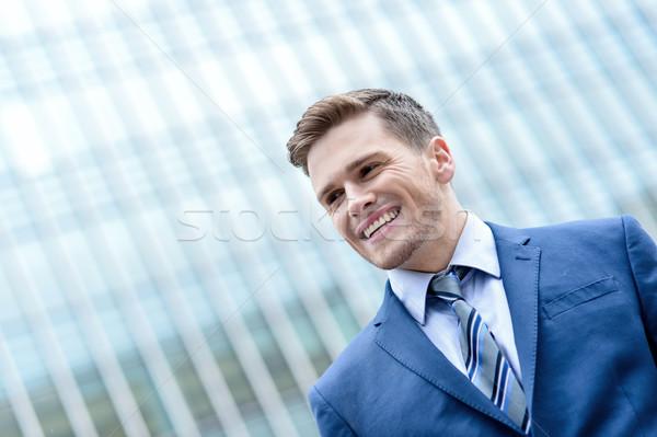 Genç gülen adam modern bina çekici işadamı Stok fotoğraf © stockyimages