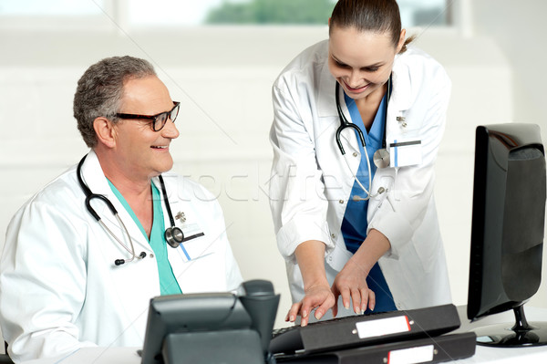 Smiling medical team working on computer Stock photo © stockyimages