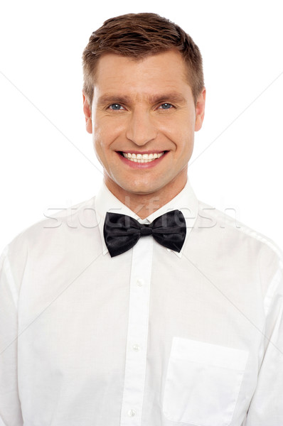 Handsome young smiling well dressed guy Stock photo © stockyimages