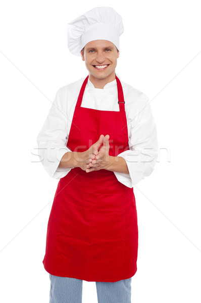 Cheerful confident male chef in proper uniform Stock photo © stockyimages
