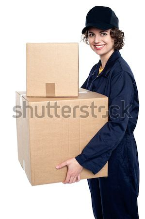 Relocation staff carrying cardboard boxes Stock photo © stockyimages