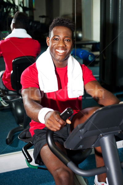 Fit man training in a fitness club Stock photo © stockyimages