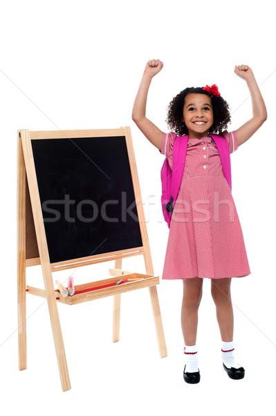 девочку школьную форму восторженный мало равномерный Сток-фото © stockyimages