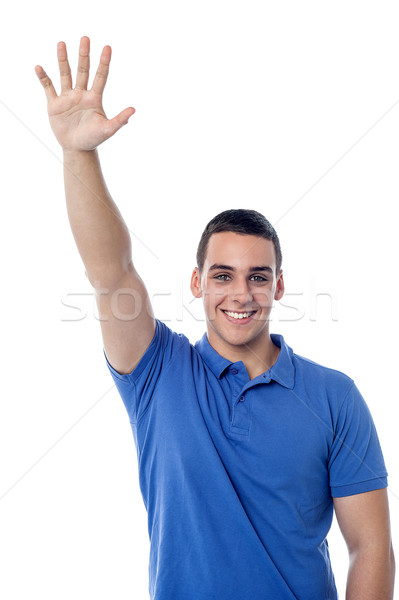 young guy waving hi to his friend Stock photo © stockyimages