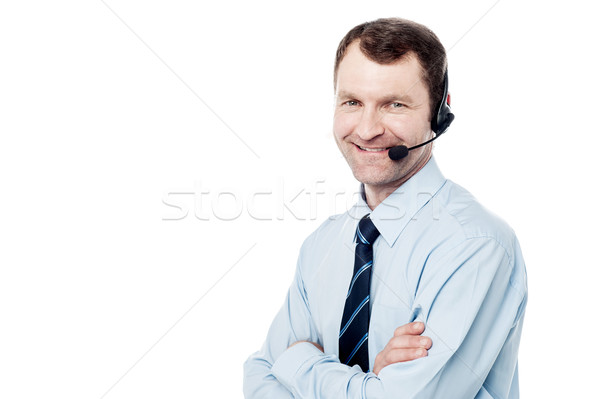 Confident call center operator isolated on white Stock photo © stockyimages