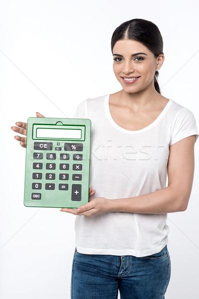 Najlepszy doradca finansowy młoda kobieta Kalkulator Zdjęcia stock © stockyimages