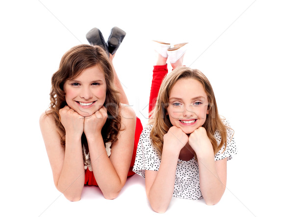 Girls posing with hands on chin. Lying on floor Stock photo © stockyimages