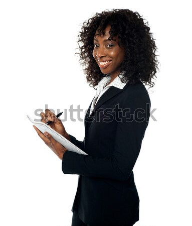 Stock photo: African woman with open palm. Copy space
