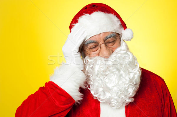 Portrait of Santa Claus suffering from headache Stock photo © stockyimages