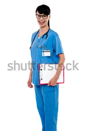 Duty doctor posing with case sheet in hand Stock photo © stockyimages