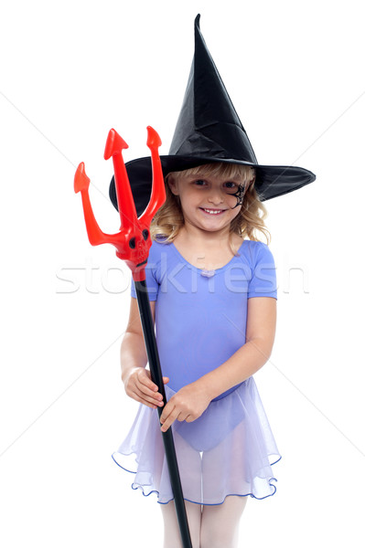 Cute girl holding pitchfork and wearing witches hat Stock photo © stockyimages