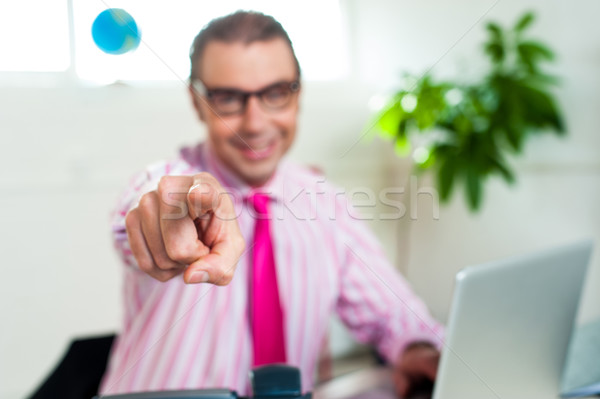 улыбаясь бизнеса профессиональных указывая из указательный палец Сток-фото © stockyimages