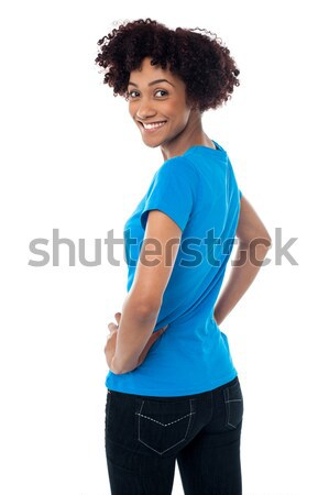 Pretty woman in casuals turning back Stock photo © stockyimages