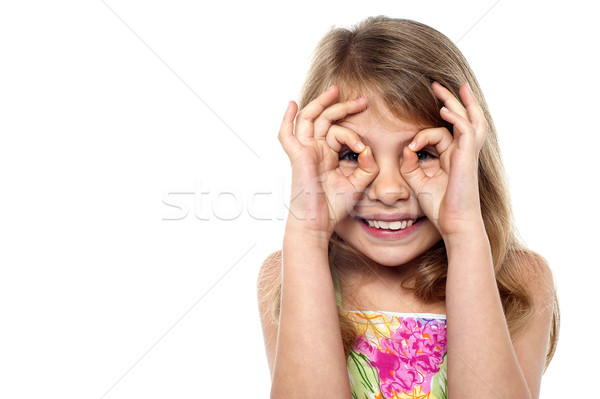 Mischievous pretty girl having fun Stock photo © stockyimages