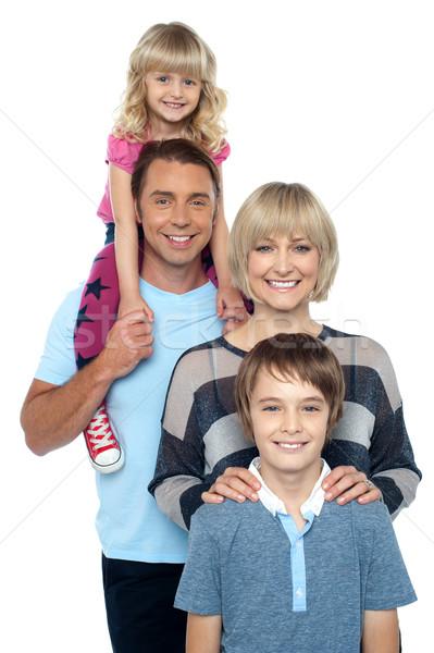портрет счастливая семья четыре человека молодые счастливым родителей Сток-фото © stockyimages