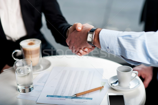 Business handshake over a coffee Stock photo © stockyimages