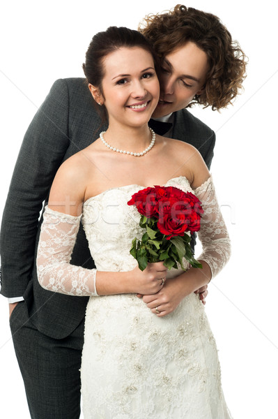 Attractive young newly married couple Stock photo © stockyimages