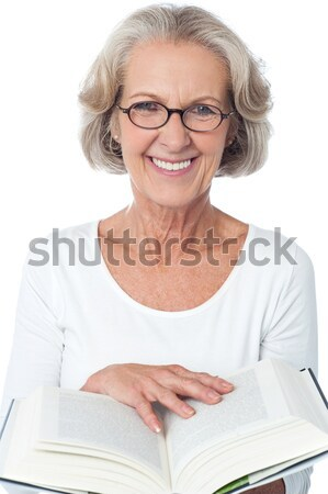 Portrait of smiling old lady, arms crossed. Stock photo © stockyimages