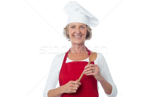 Feliz chef cuchara de madera sonriendo Foto stock © stockyimages