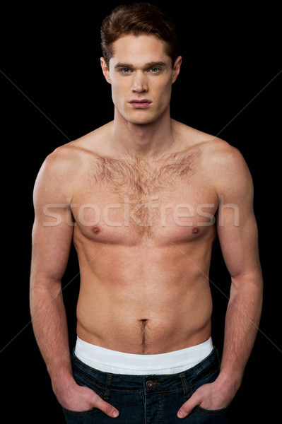 Shirtless young masculine man Stock photo © stockyimages