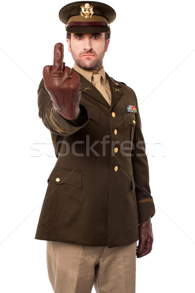 Angry army officer showing middle finger Stock photo © stockyimages