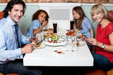 It's  my family time at restaurant Stock photo © stockyimages