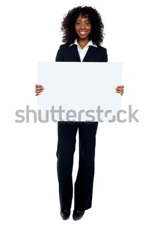 Business lady promoting big blank banner ad Stock photo © stockyimages