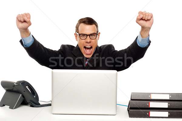 Excited businessman shouting and rejoicing Stock photo © stockyimages