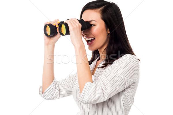 Corporate woman viewing through binoculars Stock photo © stockyimages
