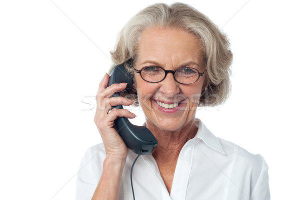 Senior lady attending phone call Stock photo © stockyimages