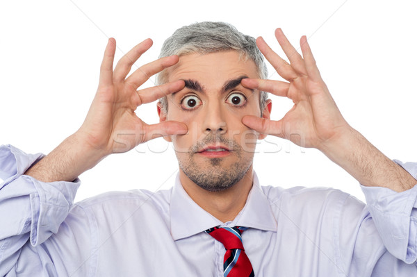 businessman with eyes wide open Stock photo © stockyimages