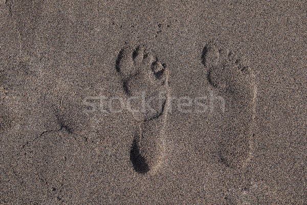 Ayak izleri kum plaj iki doku deniz Stok fotoğraf © stockyimages