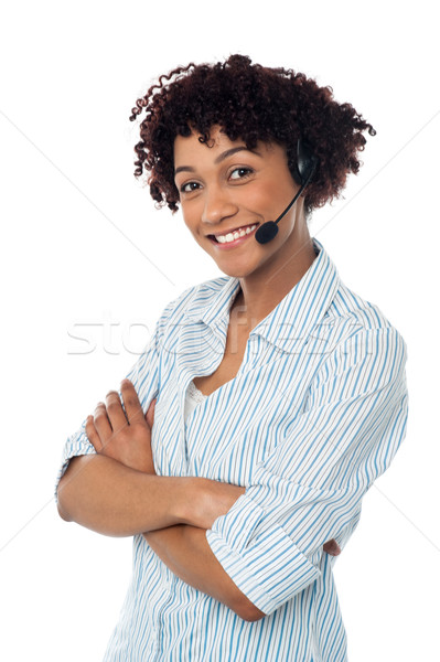 Smiling woman in hands free headset device Stock photo © stockyimages