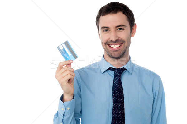 корпоративного парень дебетовая карточка улыбаясь бизнеса Сток-фото © stockyimages