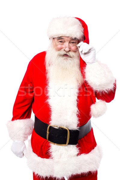 Santa Claus adjusting his spectacles Stock photo © stockyimages