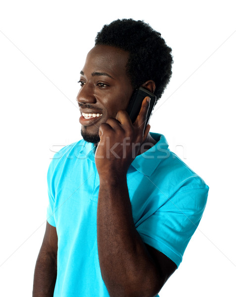 African guy communicating via cellphone Stock photo © stockyimages
