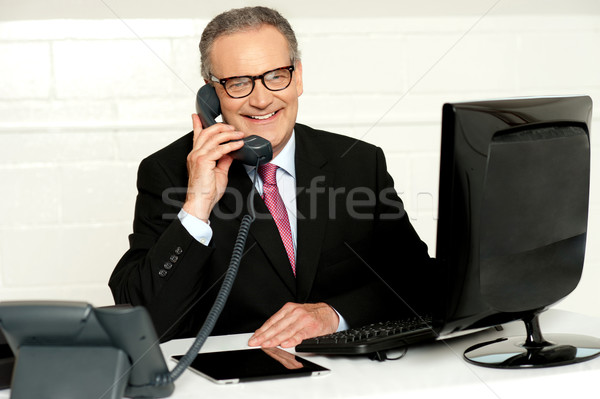 Senior businessman attending phone call Stock photo © stockyimages