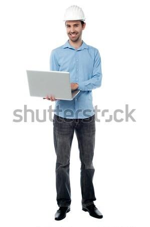 Female business secretary working on laptop Stock photo © stockyimages