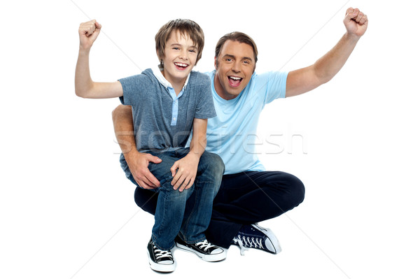 Joyous father and son cheering loud Stock photo © stockyimages