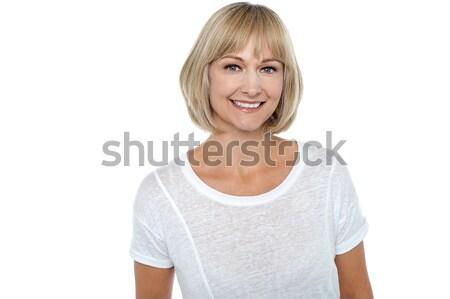Lezser portré mosolyog középkorú nő középkorú kaukázusi Stock fotó © stockyimages