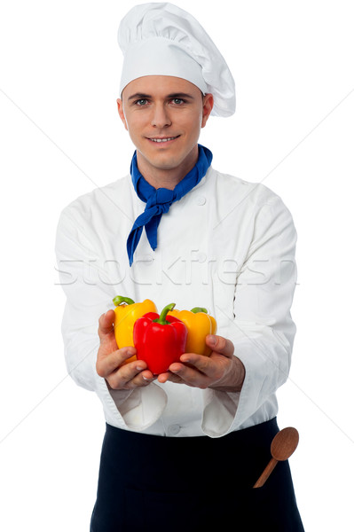 Chef showing fresh capsicums Stock photo © stockyimages